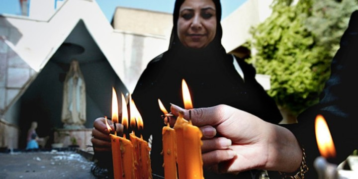 web3-blessed-mother-mary-islam-muslim-women-candles-000_nic96910-wisam-sami-afp1