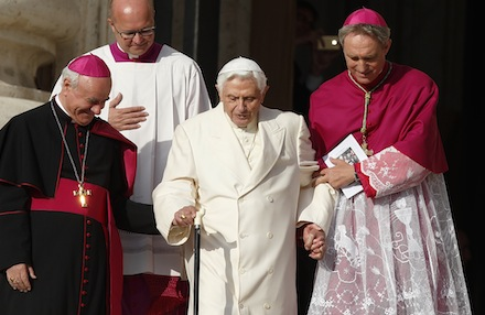 Retired Pope Benedict XVI assisted as he arrives for Pope Francis' encounter with elderly in St. Peter's Square at Vatican