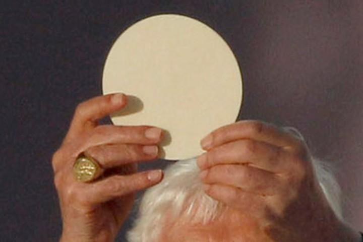 POPE BENEDICT RAISES EUCHARIST AS HE CELEBRATES MASS AT PARK IN SCOTLAND