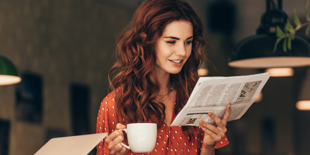 web3-woman-reading-newspaper-horoscope-coffee-shutterstock