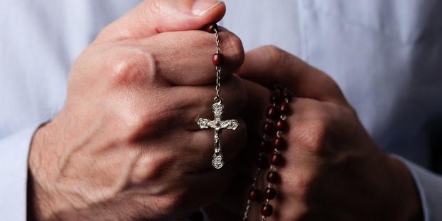 web3-man-hands-rosary-praying-shutterstock