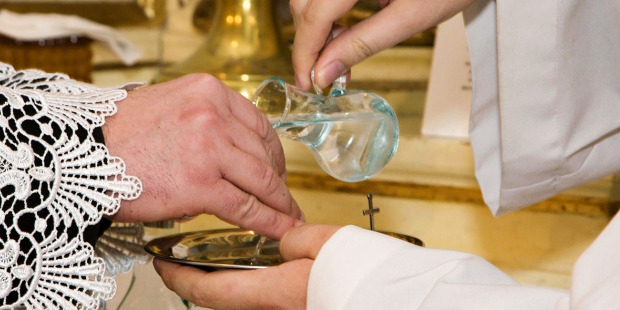 web3-hands-priest-water-liturgy-shutterstock_1346029772-renata-sedmakova